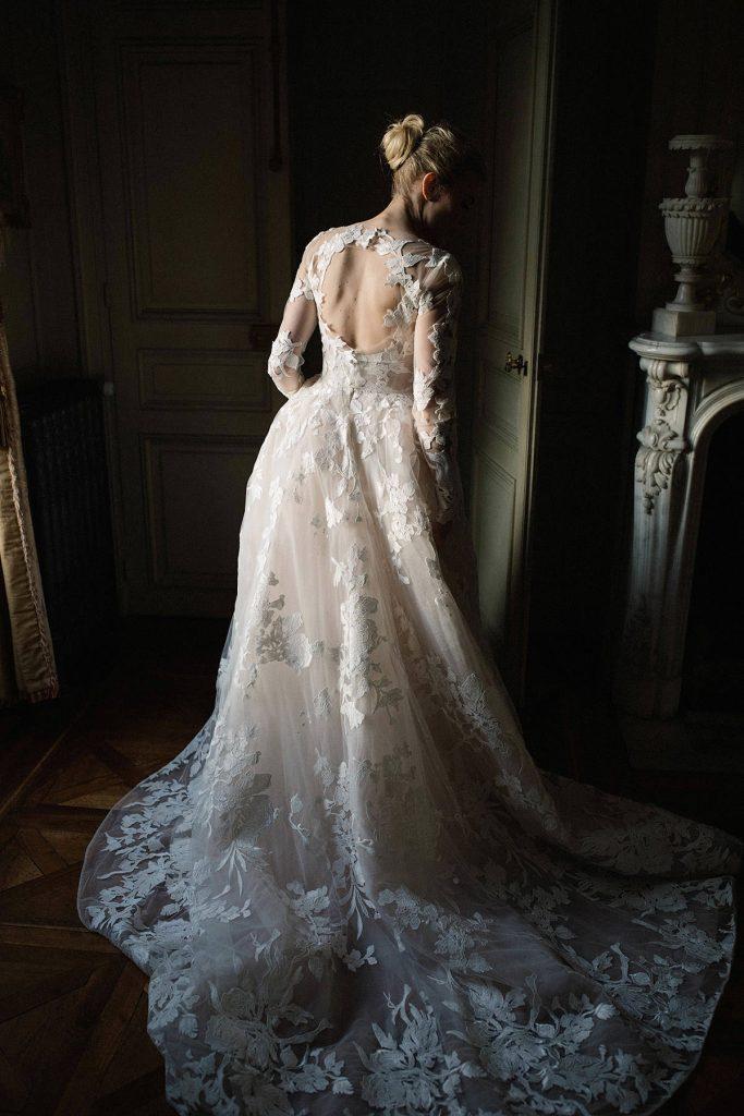 Portrait a bride wearing bespoke Monique lhuillier dress