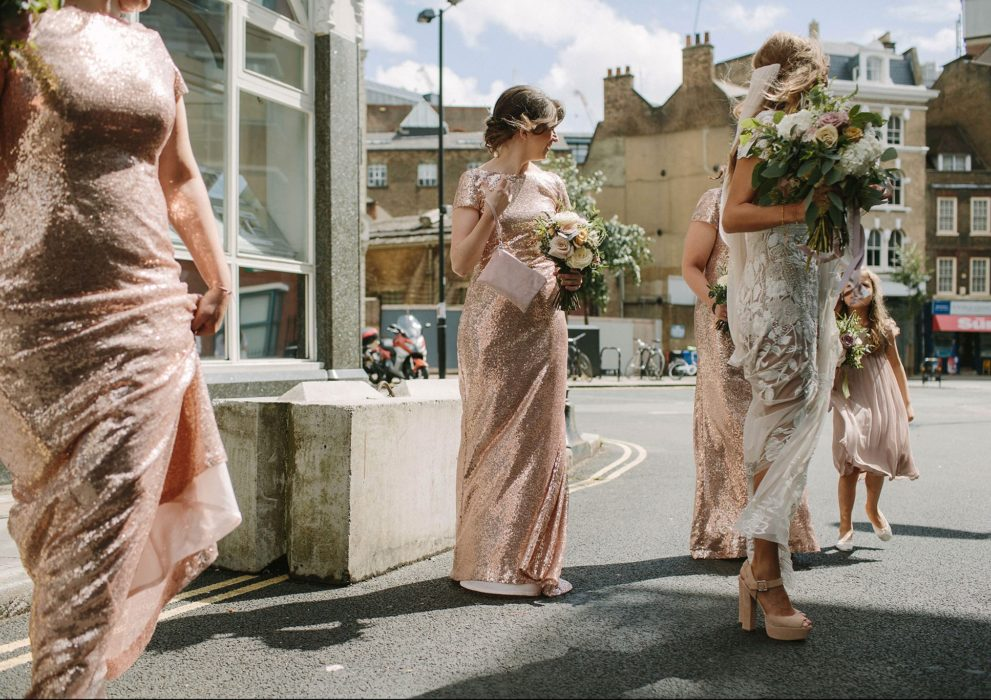 bride and her bridesmaids walking the streets of London