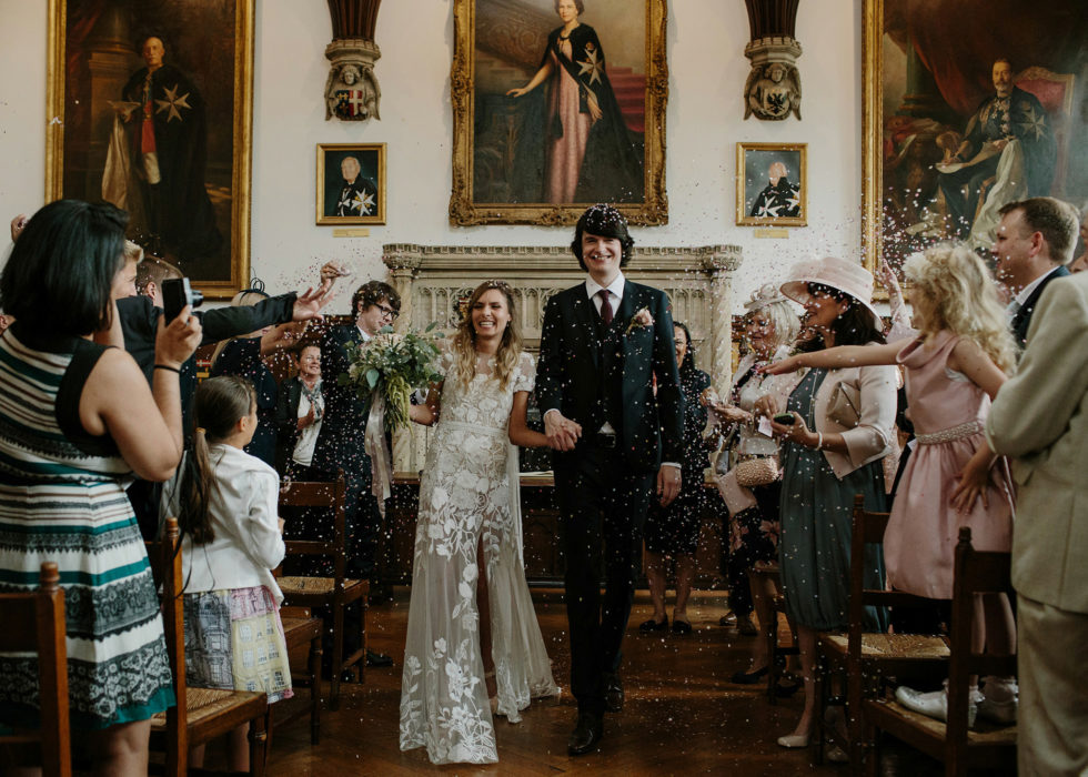 Bride and groom walking down the aisle; hermione de paula bespoke wedding dress