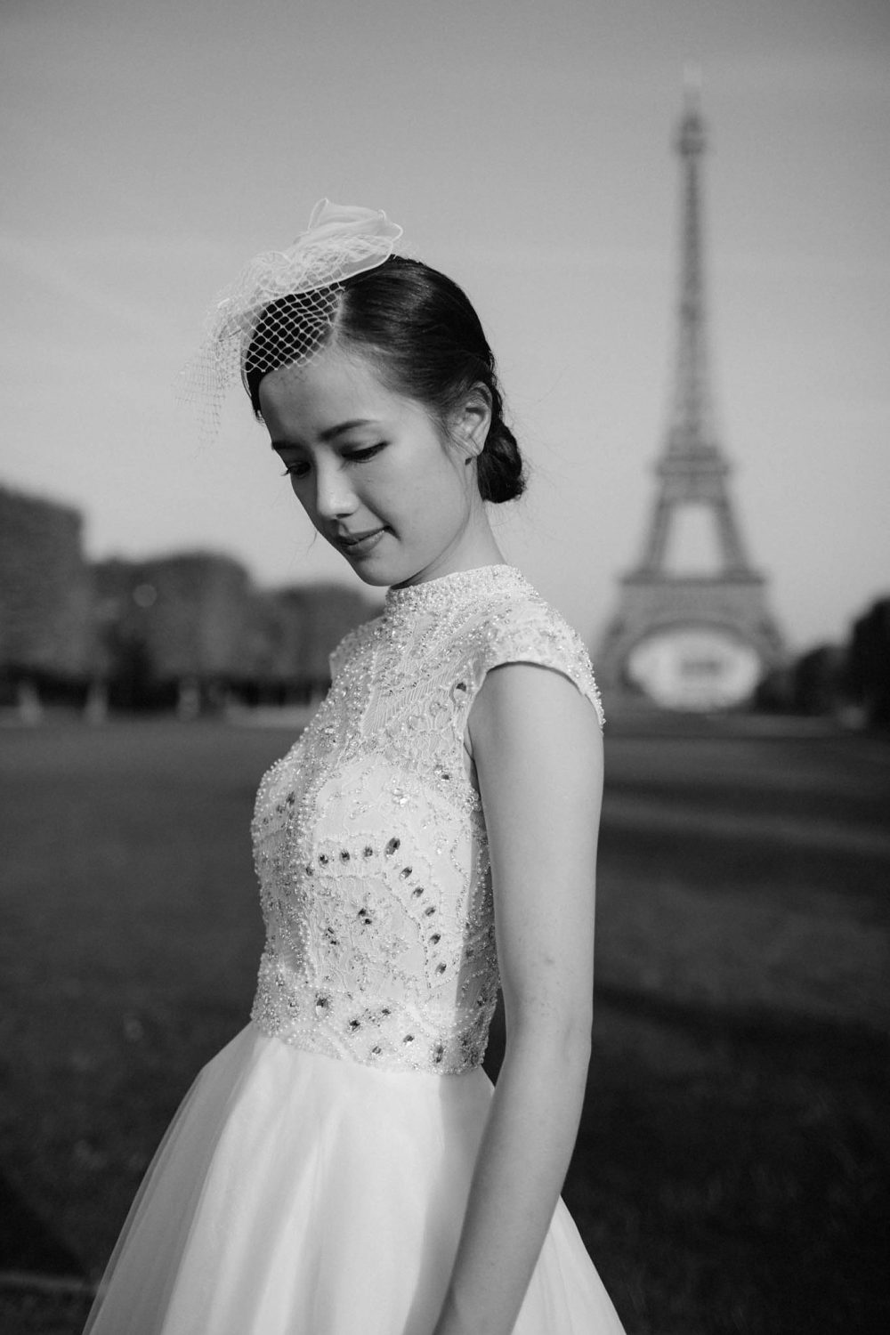 bride in front of Eiffel tower