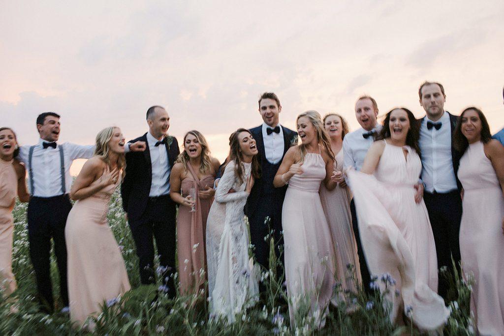 bridal party portrait at sunset