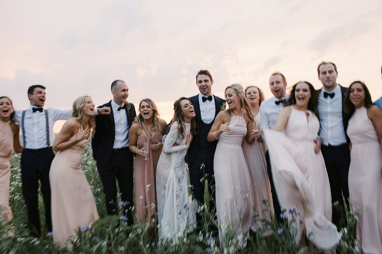 bridal party portrait at sunset