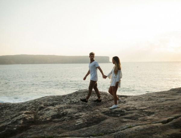 couple overlooking ocean at sunrise