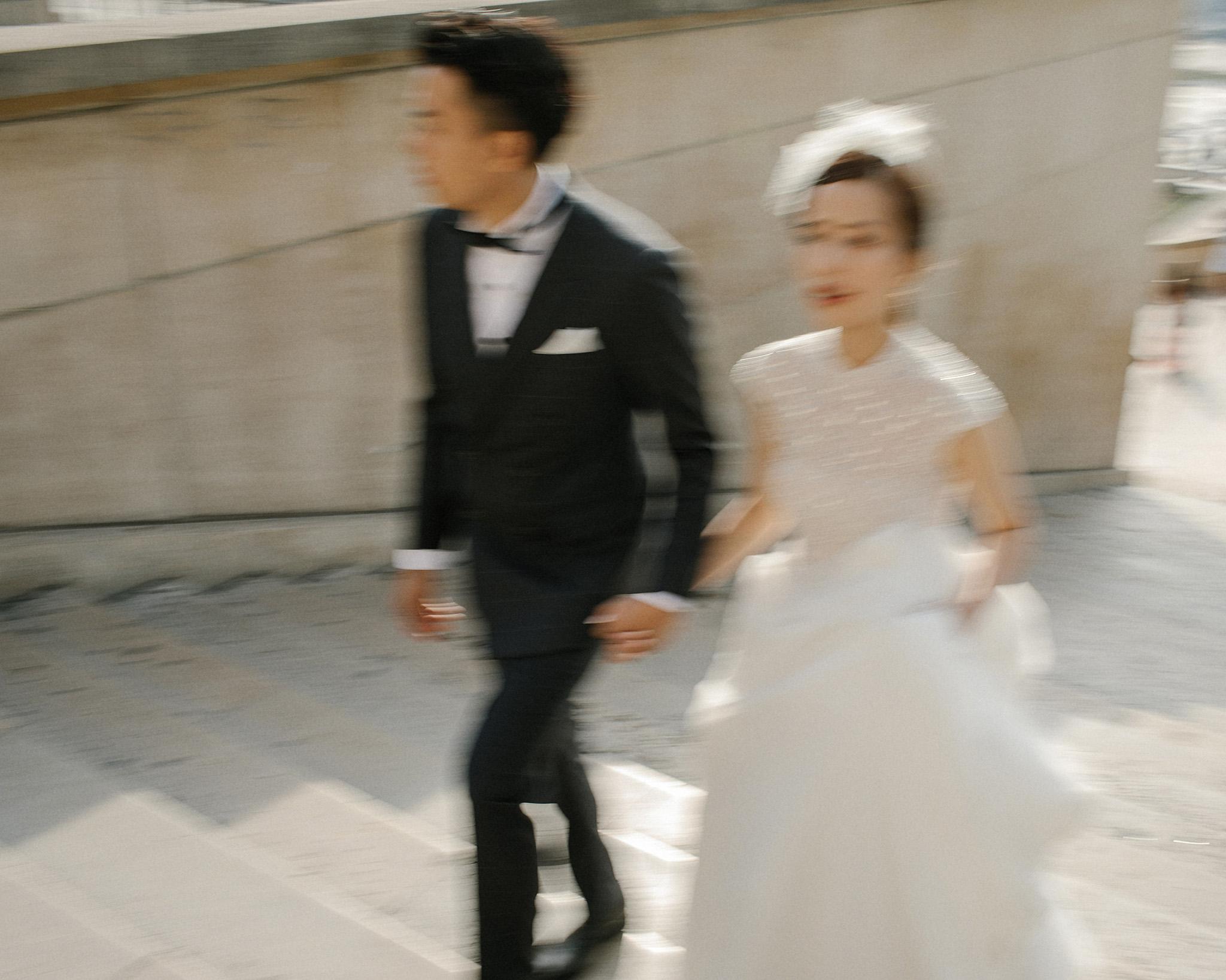 Bride wearing an oscar de la renta dress with a cape