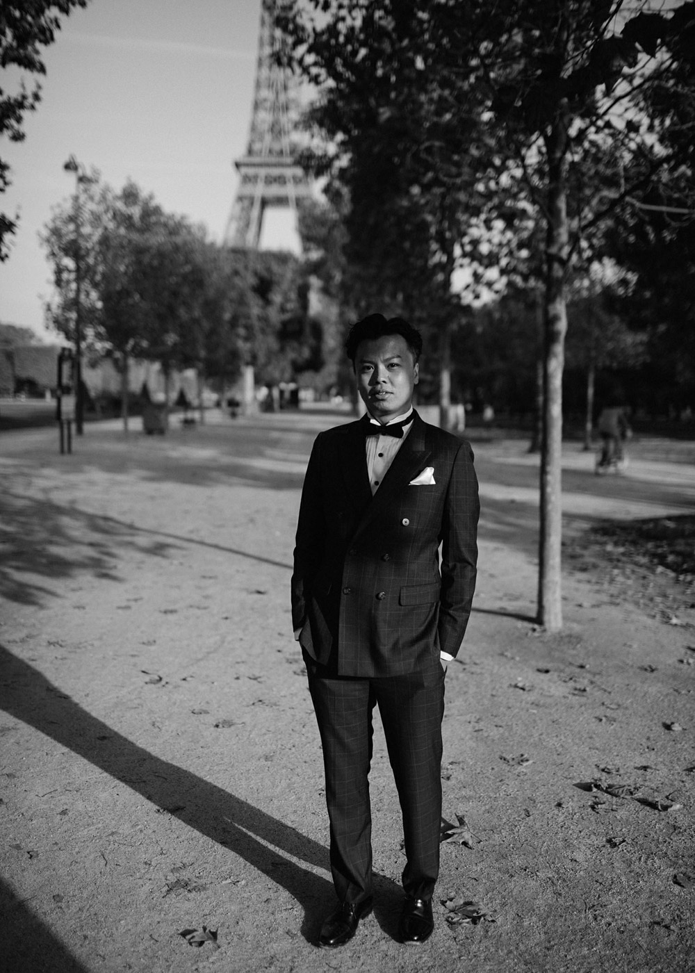 groom at the eiffel tower