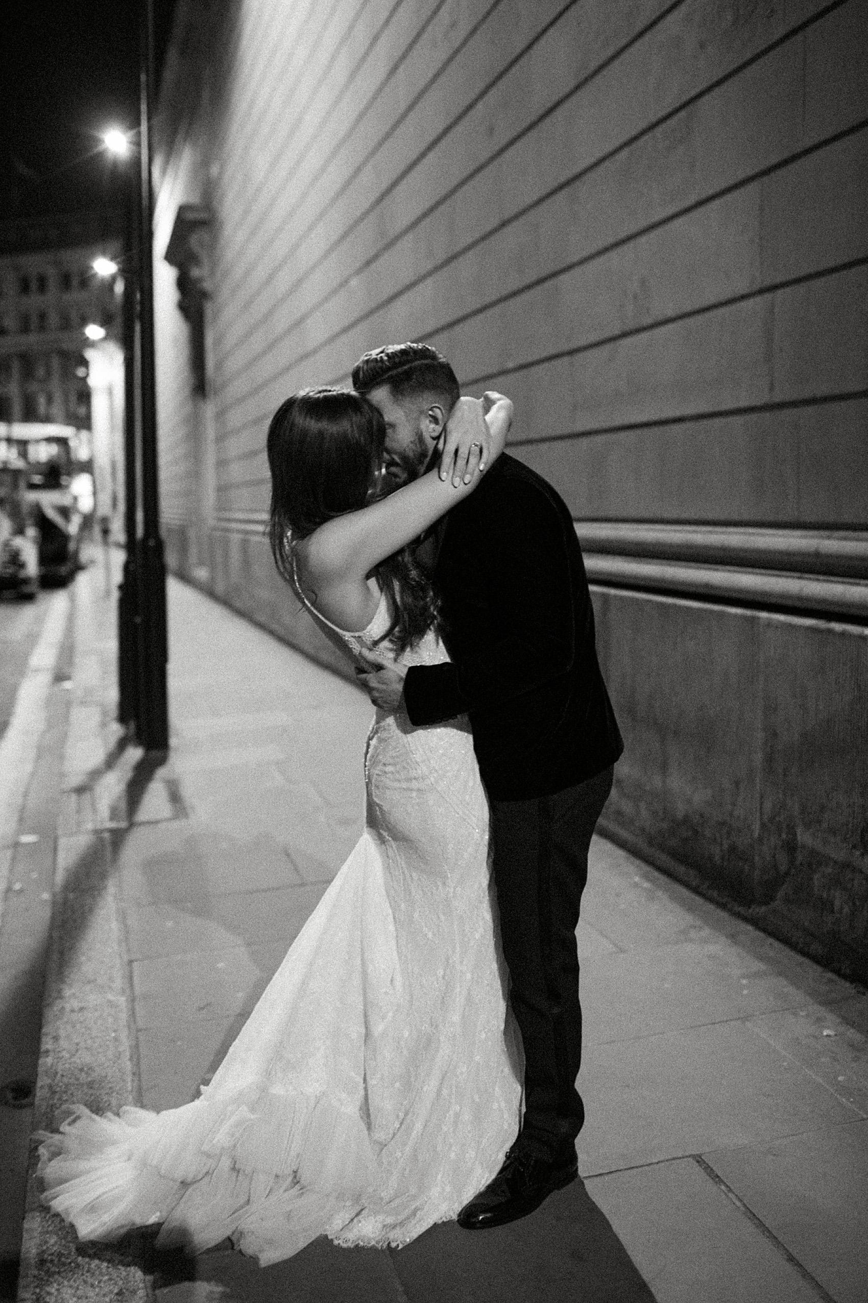 Romantic night portrait of bride and groom