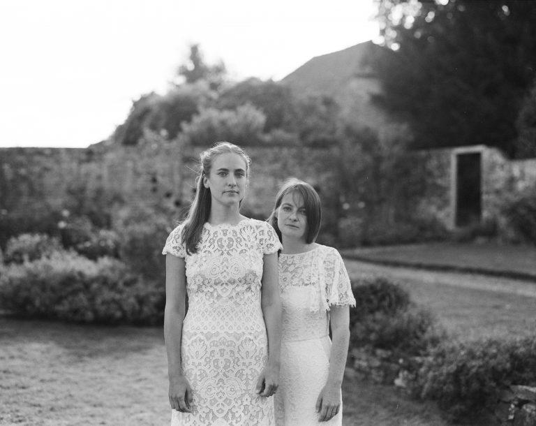 film portrait of two brides